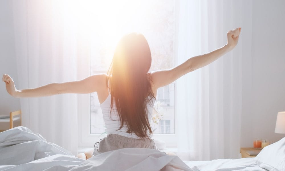 woman waking up after sleep