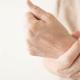 Arthritis: A hand holding a wrist in pain