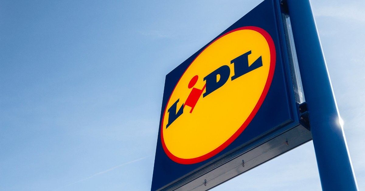 Lidl: A sign for German brand Lidl against a clear blue sky