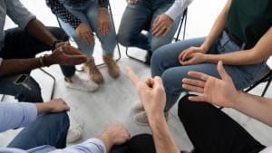Patient groups: A group of patients discussing their care in a circle
