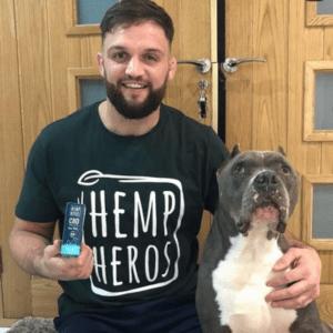 Hemp heros: A man wearing a black t-shirt stands next to a dog