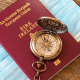 Access: A red Irish passport on top of a blue covid mask with a stop watch on top to highlight emigration