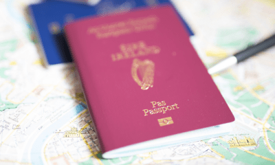 ADHD: An Irish passport lies on top of a blue European document. Both passports are ontop of a map where a pen is marking the route