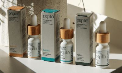 Papilo Products: A row of CBD bottles next to their boxes