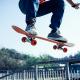 Pro - skateboarding: A man on a skateboard jumps into the air