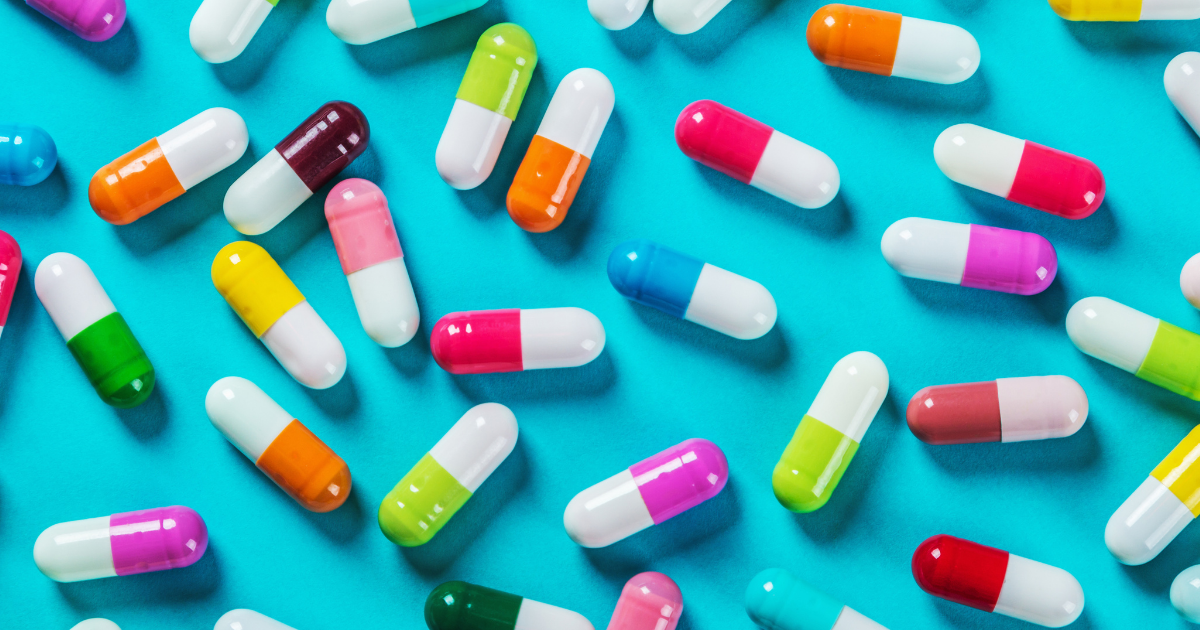 Opioid: A handful of pills on a bright blue background