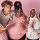 Gen-Z: A group of young people hug in front of a camera while all are wearing a light pink colour.