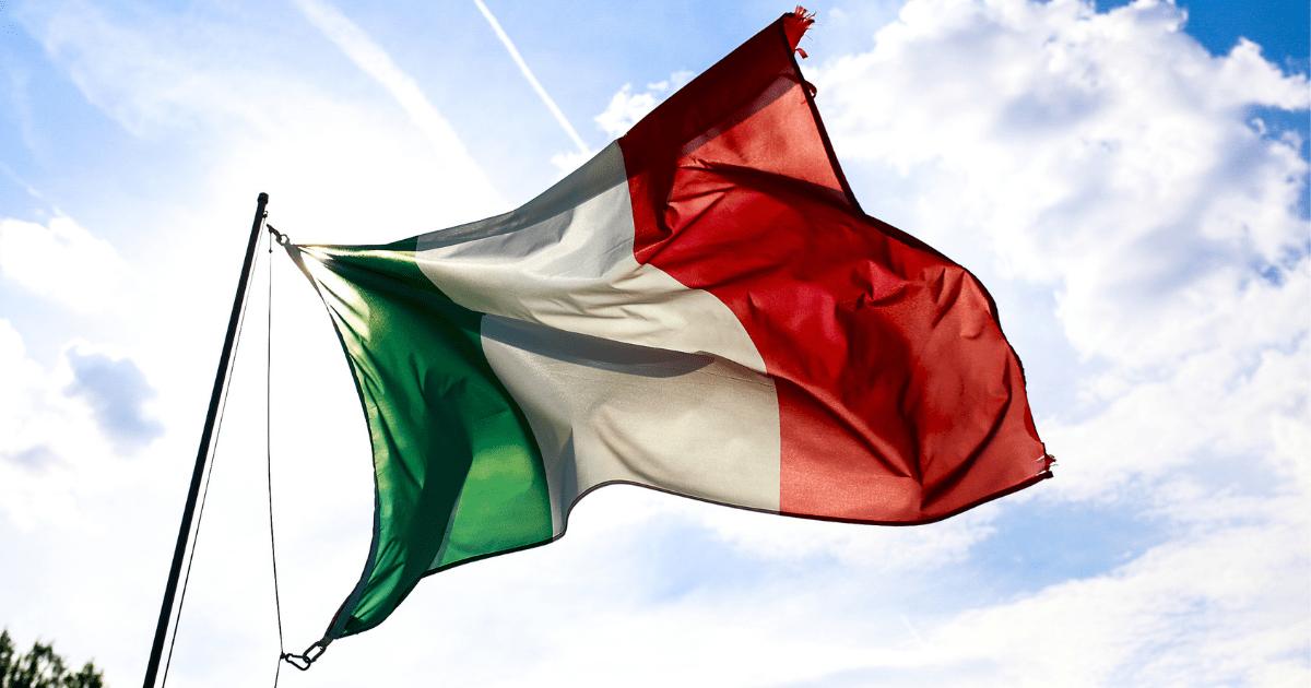 Italy: An Italian flag floating against the blue sky