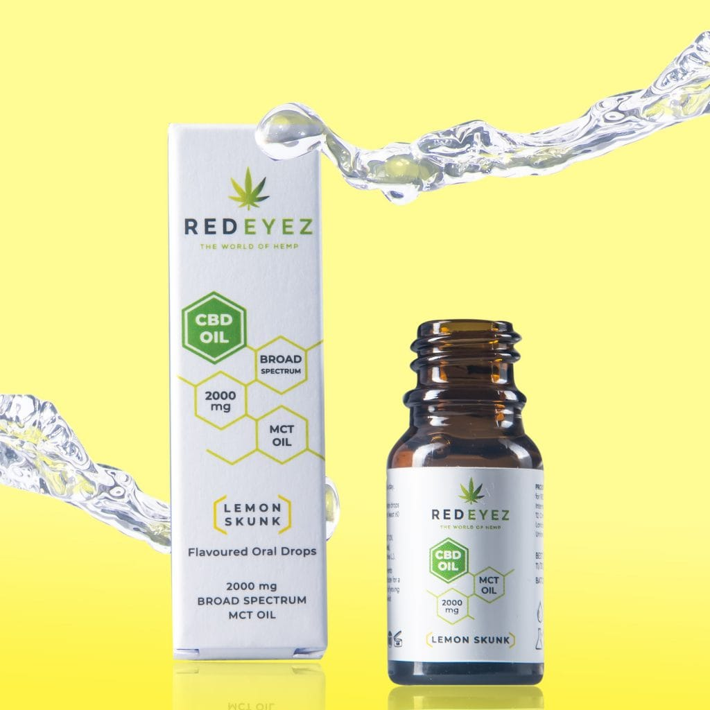 Red Eyez: A bottle of CBD oil against a yellow background. The bottle is next to the white box