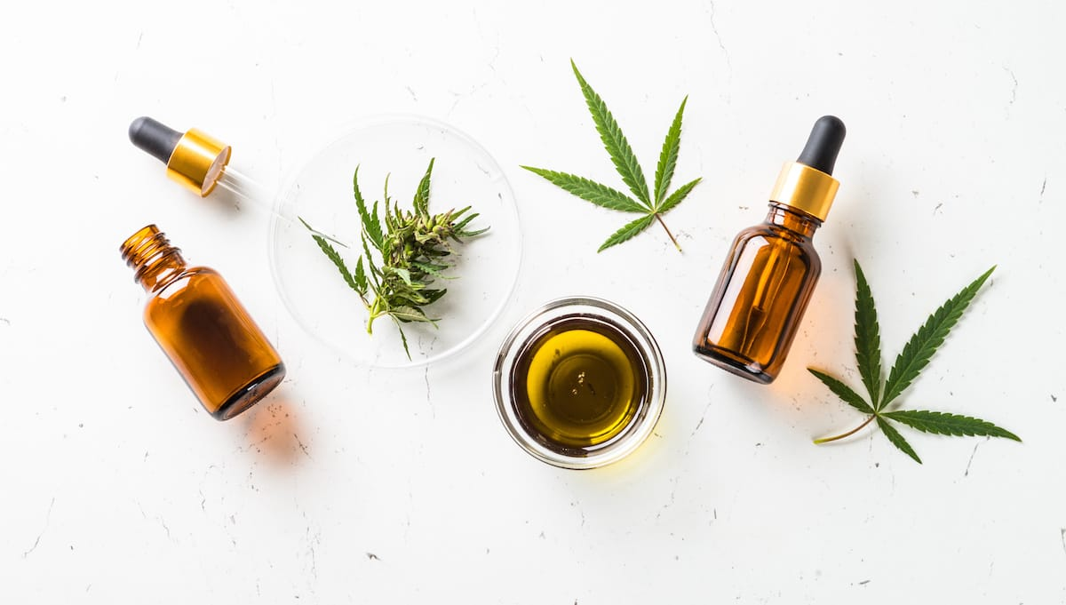 Depression: A collection of CBD bottles and cannabis leaves on a white background