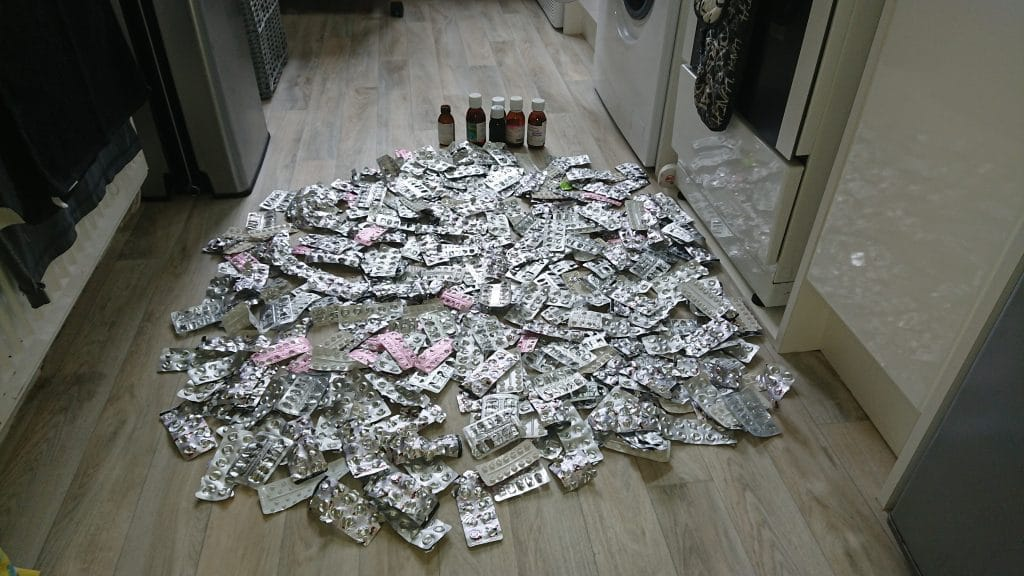 Seizure: A pile of blister packs of medication on the floor along with medication bottles