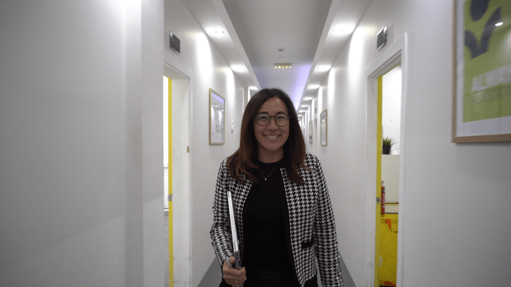 Always Pure Organics: A woman walking down a white and yellow hallway