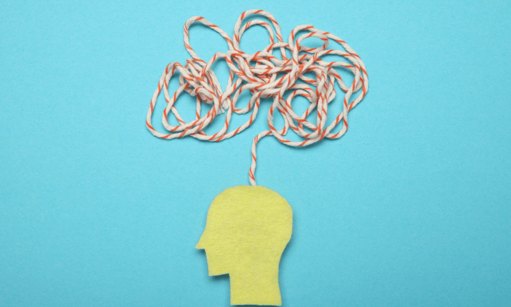 ADHD: A blue background with a cartoon head with a string jumbled up above it to represent thoughts
