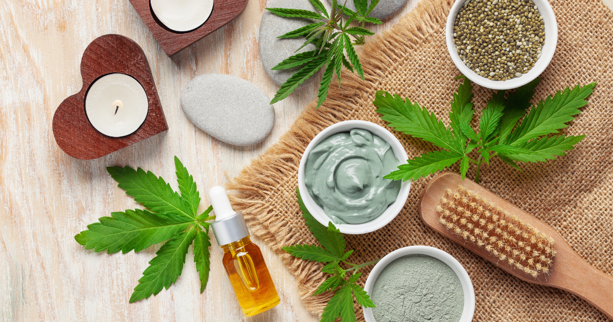 Depression: A collection of skincare products open on a bath mat with CBD oils and cannabis leaves beside them